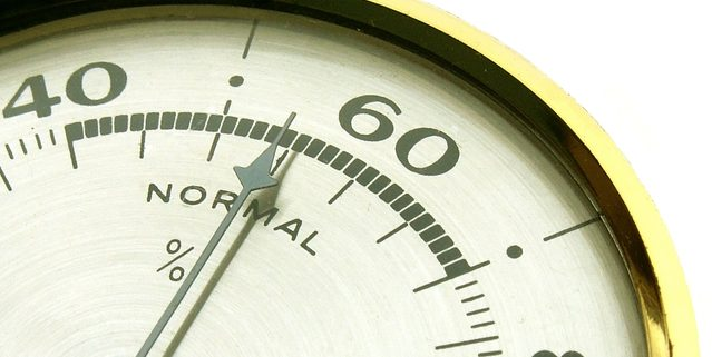 needle on a hygrometer pointing to normal
